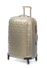 Beige plastic suitcase on wheels for travel.