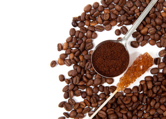 Coffee grains, spoon of grind grains and crystal sugar