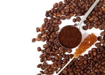 Coffee grains, spoon of grind grains and crystal sugar