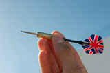 Throwing dart with the flag of UK on the stabilizing flaps
