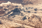View at the brown mountains from airplane