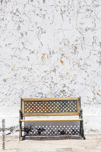 old white wall  with bench