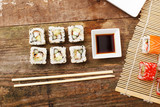 Six pieces of sushi with soy and chopsticks