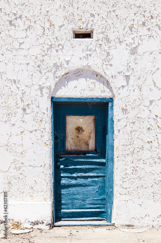 old white wall  with window in detail