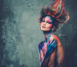 Woman muse with creative body art and hairdo