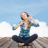 young woman listeting to music with headphones