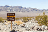 road sign in Death Valley warning travelers of Caution Extreme H