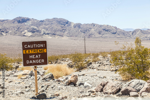 road sign in Death Valley warning travelers of Caution Extreme H - 62309219