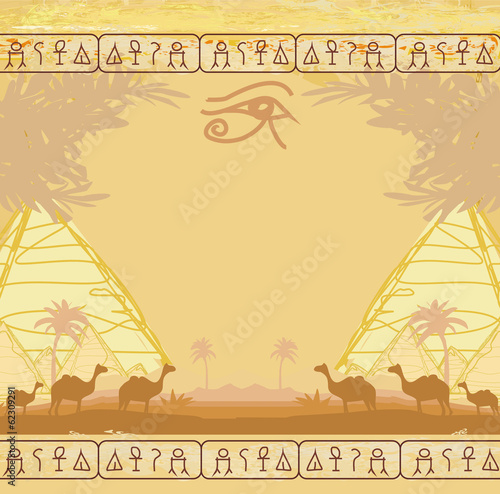 Traditional Horus Eye and camel caravan in wild africa landscape