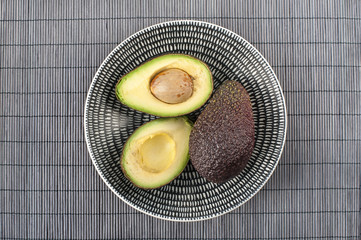 Ripe avocado on ceramic plate. Closeup.