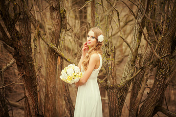 Bride outdoors in a sunny forest