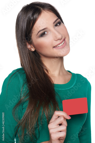 Smiling female showing blank credit card