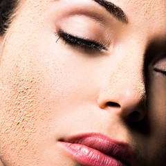 Face of a woman with cosmetic powder on skin