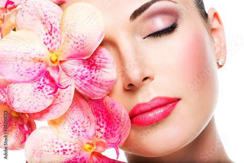 Relaxed beautiful face of a young girl with clear skin and pink