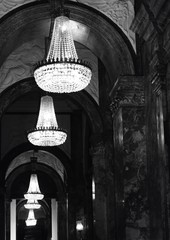 chandeliers reflecting in a mirror in black and white