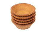 Stack of empty dark tartlets