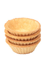 Stack of empty tartlets on white