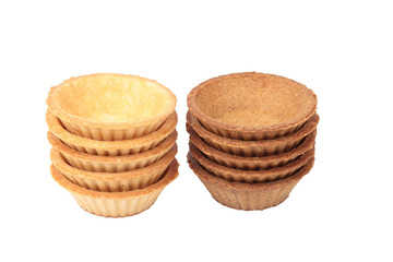 Stack of empty light and dark tartlets
