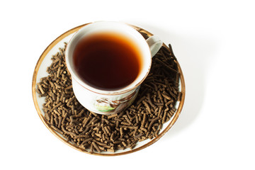 white cup with black tea on a white background cypress