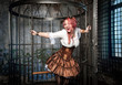 Screaming beautiful steampunk woman in the cage