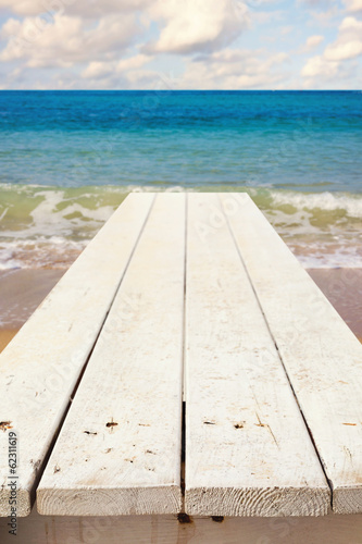Nautical background with empty wooden deck over sea
