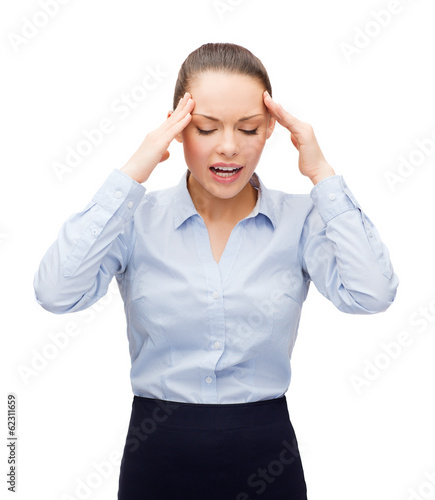 upset businesswoman having headache