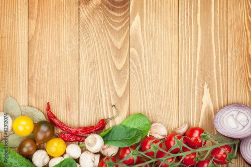 Fresh ingredients for cooking: tomato, cucumber, mushroom and sp