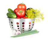 Fresh ripe vegetables in colander