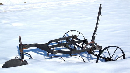 Old agri tool stuck on the snow