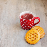 Tea cup and cookies on wooden table
