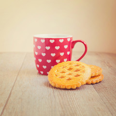 Cup of tea and cookies with retro filter