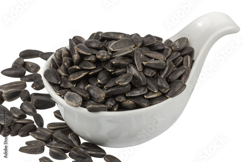 sunflower seeds in porcelain bowl