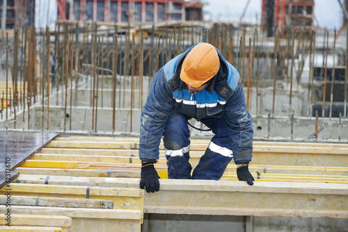 construction worker preparing formwork