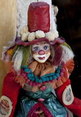 Puppet:colorful clown dressed with clothes.