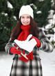 Young woman with ice skate in winter outdoor