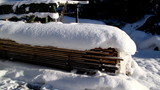 Set of woods piled full of snow