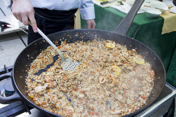 Awarded Chef Serving Fruits of the sea Risotto-selective focus