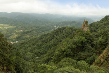 Landscape of lush hills, valley, crag and verdant forest
