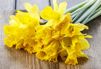 Yellow daffodils on wooden background
