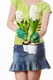 Young woman holding hyacinth flowers isolated on white back