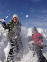 two boys have snowball fight