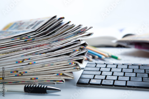 stack of newspapers and keyboard close-up