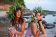 Two beautiful Girls with summer wreath of grass and flowers on t