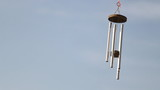 wind chime tube mobile, blue sky background poster