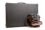 Old suitcase and camera