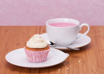 Cupcake And Fruit Tea Cup On Wooden Background