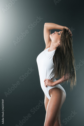 Healthy woman looking after her figure, profile