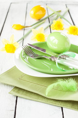 Easter or spring table setting with fresh daffodil flowers