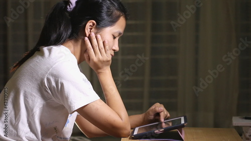 Woman using a tablet alone.