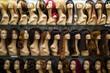 Leinwanddruck Bild - rows of mannequins ina wig shop